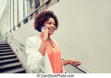 happy african businesswoman calling on smartphone -...