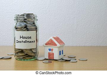 Money saving for house installment in the glass bottle