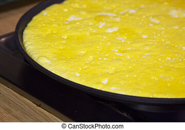 Omelette in pan, close up, horizontal image