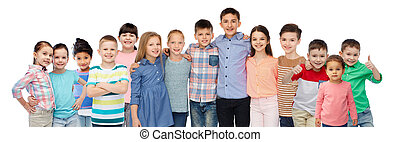 group of happy smiling children hugging