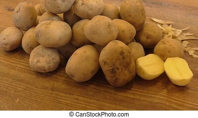 Potatoes on wooden table close up