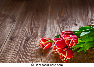 Red tulps. Flowers on wooden background. Copy spase. - lovey...