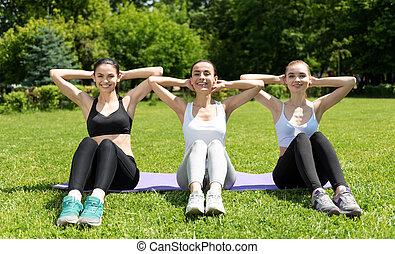 Joyful women working their abs - Right approach Positive...