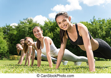 Positive women doing a press up - Sport enthusiasts....