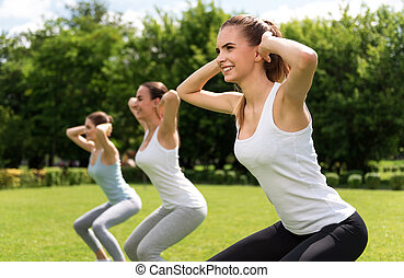 Cheerful women doing sport exercises - Follow healthy way of...