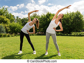 Joyful women doing sport exercises - Stay positive Joyful...