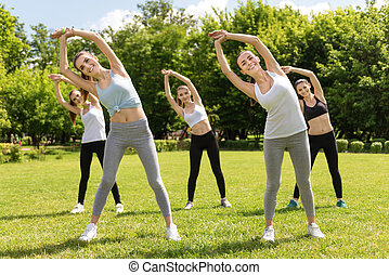 Positive women doing sport exercises outdoors - Turn right....