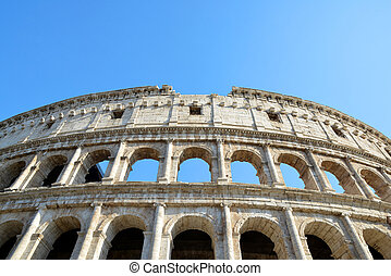 Flavian Amphitheatre or Colosseum in Rome with blue sky in...