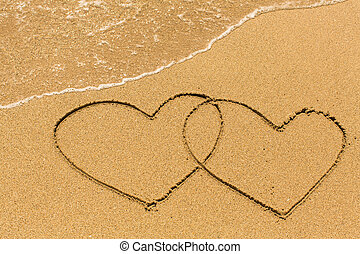 Two of hearts drawn on sandy beach - Two of hearts drawn on...