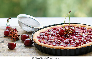 Summer dessert. Homemade cherry pie, tart with powdered...