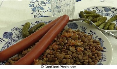 Lentil with sausages and pickles - Cooked lentil with spicy...