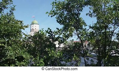 View of Vyborg castle, Russia, with green leaves at...