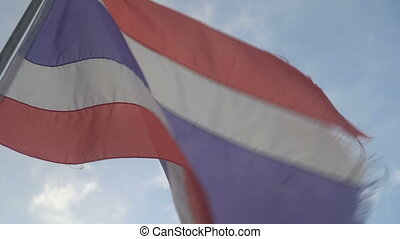 Thai flag blowing in the wind on sky