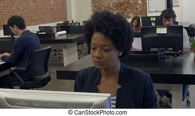 African american business woman working desktop computer...