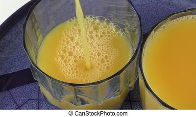 In a glass filled with orange juice