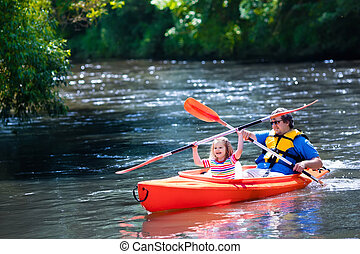 Father and child kayaking in summer - Family on kayaks and...