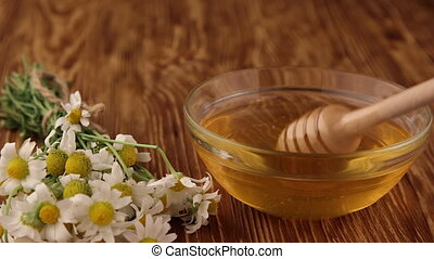 Extraction honey with a dipper, Honey is a source of health,...