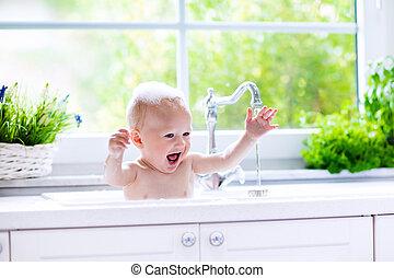 Little baby taking bath - Baby taking bath in kitchen sink....