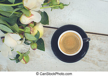 Coffee and flowers peony A cup of coffee and Peonies on a...