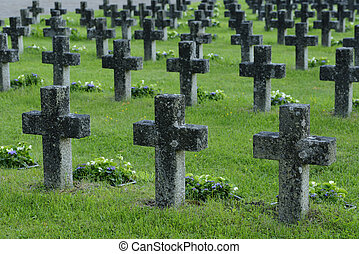 rows of stone crosses in a military cemetery