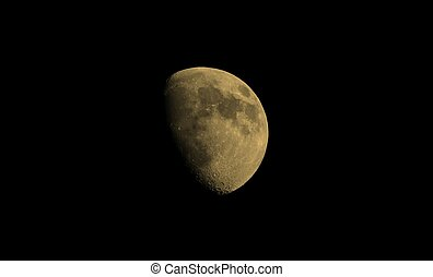 Gibbous moon sepia - Gibbous moon over dark black sky seen...