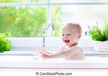 Little baby taking bath - Baby taking bath in kitchen sink....