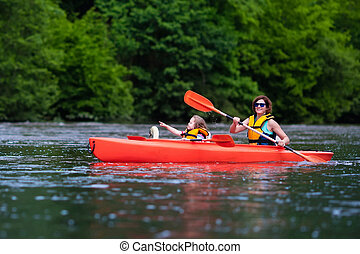 Mother and child in a kayak