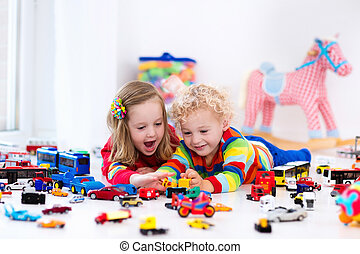 Little kids playing with toy cars - Little toddler boy and...