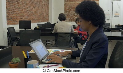 African american business woman typing using laptop computer...