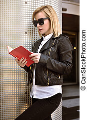 girl reading book - young hipster girl reading a red book