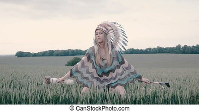 Indian woman walking in the field - Native American Indian...