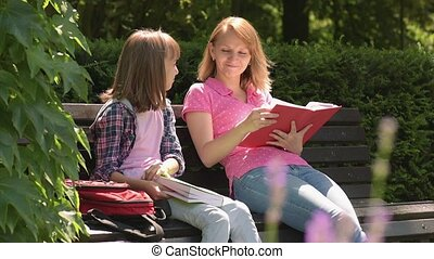 Mother and daughter reading books