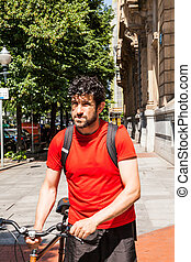 Urban athlete walking with a bike - Urban athlete walking...