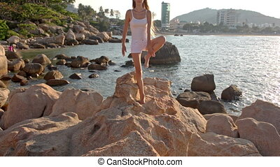 Young Blond Girl Does Yoga Pose on Beach