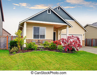 Beautiful curb appeal of sweet beige house with green front garden