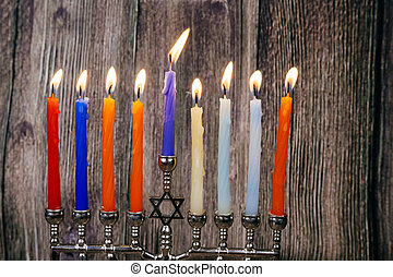 Jewish holiday Hanukkah background with menorah over...