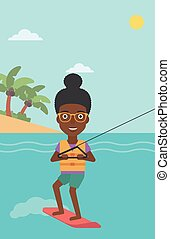 Professional wakeboard sports woman - An african-american...