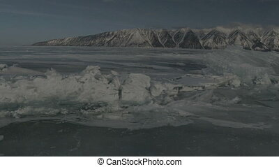 Large blocks of ice crack near Holy Nose Peninsula....