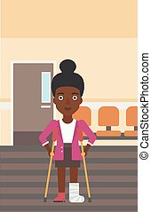 Woman with broken leg and crutches. - An african-american...