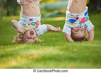 The two little baby girls hanging upside down