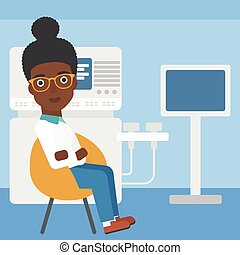Female ultrasound doctor - An african-american female...