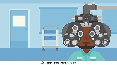 Patient during eye examination. - An african-american man...
