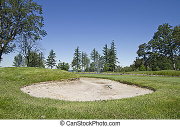Golf Course Sand Trap on the Green with Blue Sky