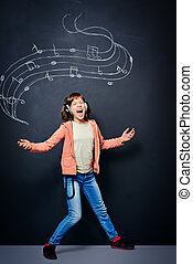 music expression - Expressive teen girl enjoys singing a...