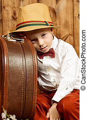 tourist with suitcase - Cute little boy in elegant clothes...