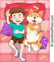 Boy and pet dog sleeping on bed