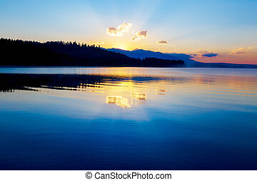 beautiful landscape with mountains and lake at dawn in...