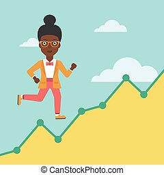 Business woman running upstairs. - An african-american...