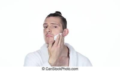 Man applying shaving foam Hair tied in bun White background...