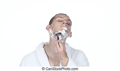 Young guy makes mornings procedure and shaving White...